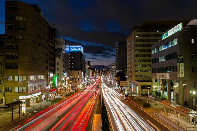 Illuminated city road at night