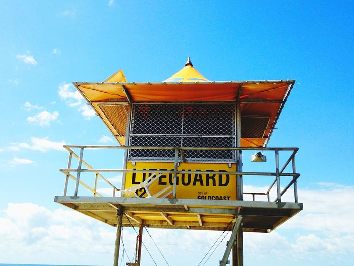 Low angle view of lifeguard hut against sky