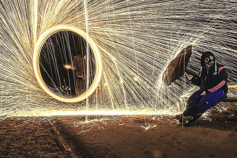 Lifestyles One Person Real People Men People Adults Only Adult Night Nature Steelwool Steelwoolphotography Gasmaske Nightphotography Nightlife . Firewood Wall Steel Structure  Regenschirm Parkbank The City Light