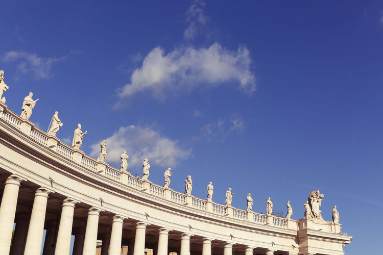 Saint Peter's Basilica Vatican Architectural Column Architecture Art And Craft Blue Building Exterior Built Structure Cloud - Sky Colonnade Day History Human Representation Low Angle View No People Ornate Outdoors Sculpture Sky St Peters Basilica Statue The Past Tourism Travel Travel Destinations