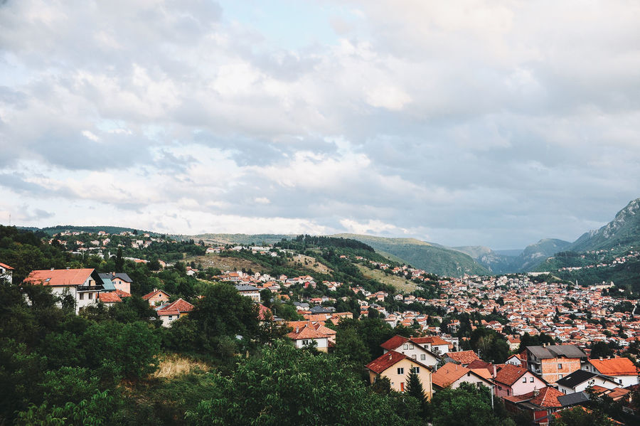 BIH Bosnia And Herzegovina Architecture Beauty In Nature Bosnia Building Exterior Built Structure Cloud - Sky Community Country House Day High Angle View House Nature No People Outdoors Residential Building Roof Sarajevo Scenics Sky Tiled Roof  Town Tree