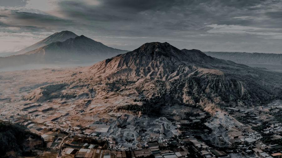Scenic view of volcanic mountain range against sky
