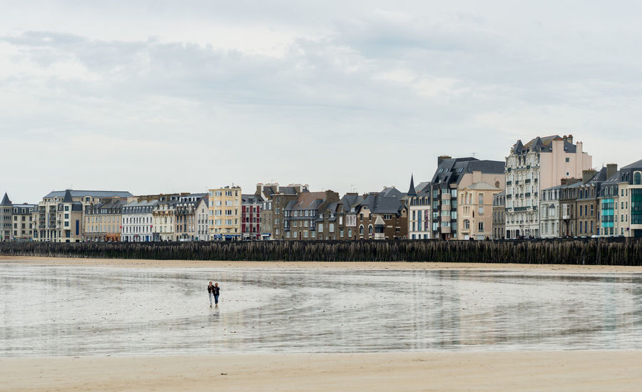 Architecture Beach Bretagne Building Exterior Built Structure City Cloudy Couple Date Day France Lonely Men Nature One Person Outdoors People Real People Reflection Saint-Malo Sea Sky Tide Water Waterfront