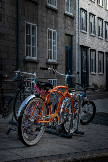 Bicycles parked on street by buildings
