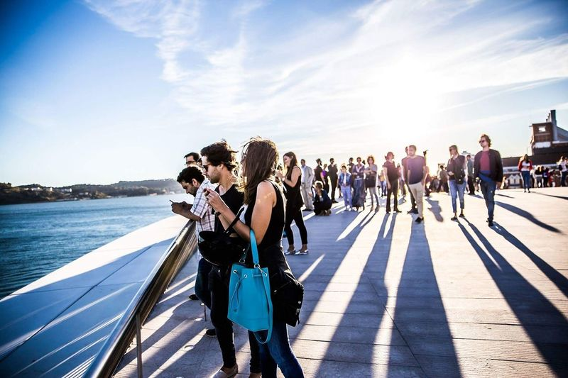 Maat Lisbon Sun Love Sunlight Shadow Large Group Of People Sky Full Length Leisure Activity Vacations Tourist Person Sunny Day Togetherness Enjoyment Carefree Weekend Activities Cloud - Sky Tourism Summer Outdoors First Eyeem Photo