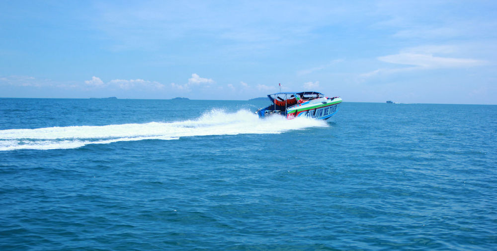 Sea Water Motion Transportation Nautical Vessel Sky Waterfront Mode Of Transportation Speed Sport Leisure Activity Beauty In Nature Day Horizon Over Water Scenics - Nature Real People People Nature Men Jet Boat Outdoors Riding