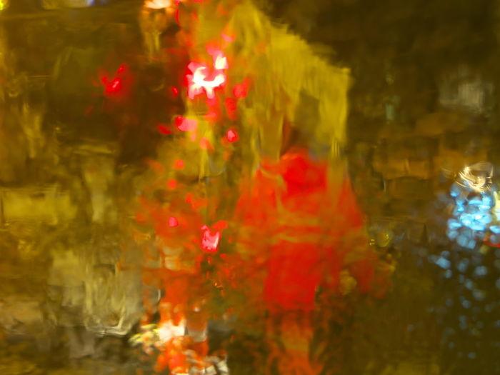 Close-up of illuminated red lanterns hanging at night