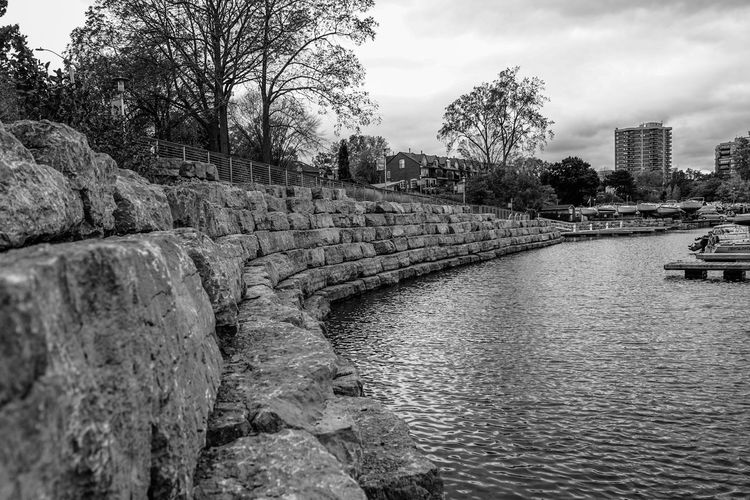 oakville harbour by the lake Stone Wall Blackandwhite Monochrome Harbour Dock Boats Lake Tree City Water River Sky Architecture Cloud - Sky