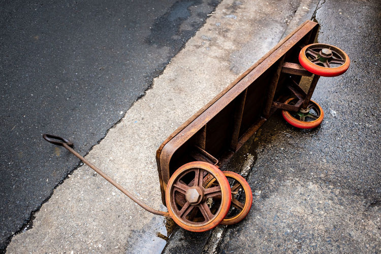 Abandoned rustic trolley on a road. Abondoned Day Industrial Industrial Trash Metal No People Object Object Photography Objects Outdoors Road Rust Rustic Rustic Style Rustic Trolley Rusty Metal Steet Life Street Streetstyle Tire Transportation Trash Trolley Vintage Trolley Car