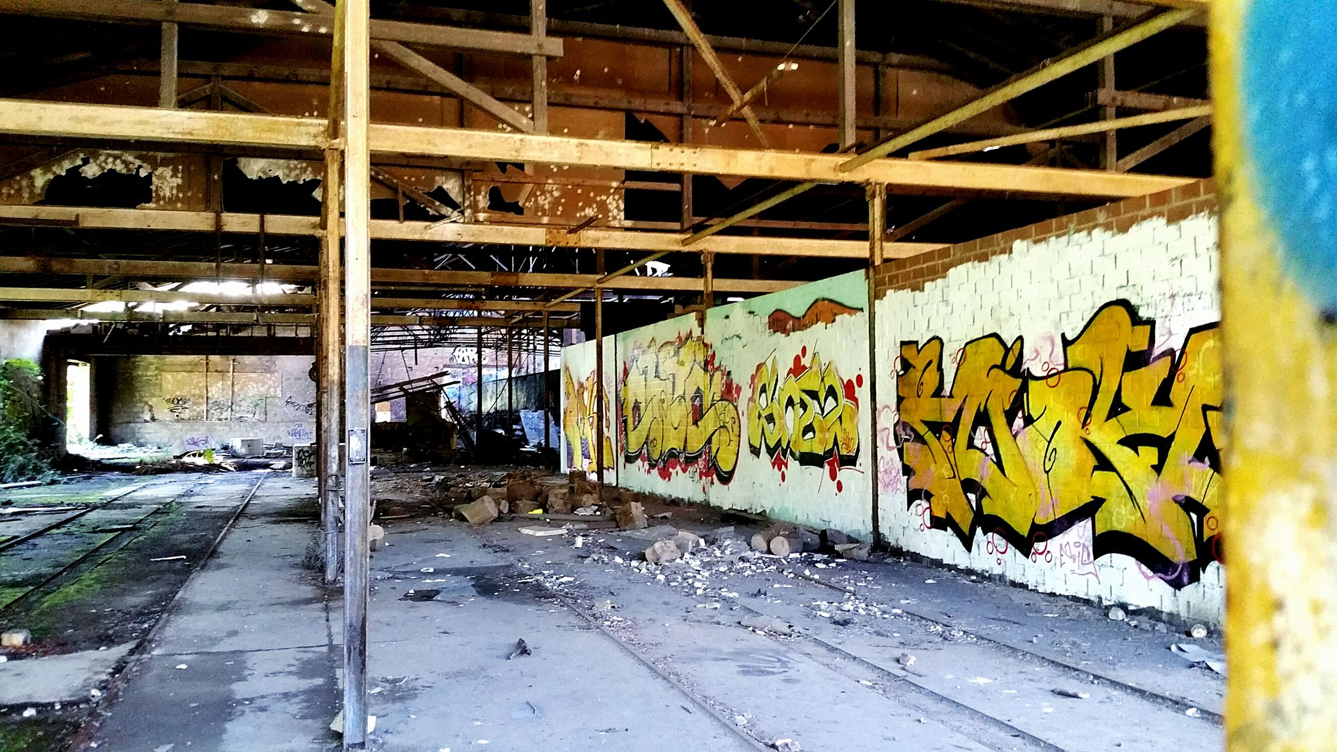 graffiti, architecture, built structure, wall - building feature, abandoned, damaged, building exterior, run-down, obsolete, deterioration, art, text, street art, creativity, vandalism, weathered, art and craft, wall, building, old