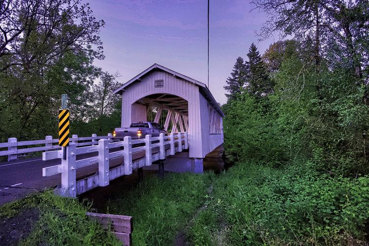 Built structure on bridge against sky