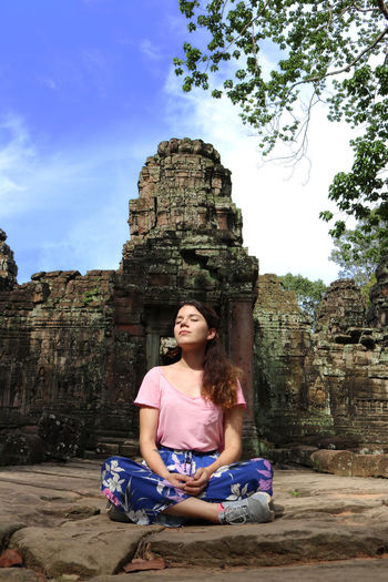 Angkor Wat, Cambodia Meditation Angkor Wat Architecture Built Structure Casual Clothing Day Front View Full Length History Leisure Activity Lifestyles Nature One Person Outdoors Real People Religion Ruined Sitting Sky Spirituality The Past Young Adult Young Women Zen My Best Travel Photo A New Beginning This Is Strength 50 Ways Of Seeing: Gratitude Moments Of Happiness 2018 In One Photograph International Women's Day 2019 Exploring Fun The Traveler - 2019 EyeEm Awards