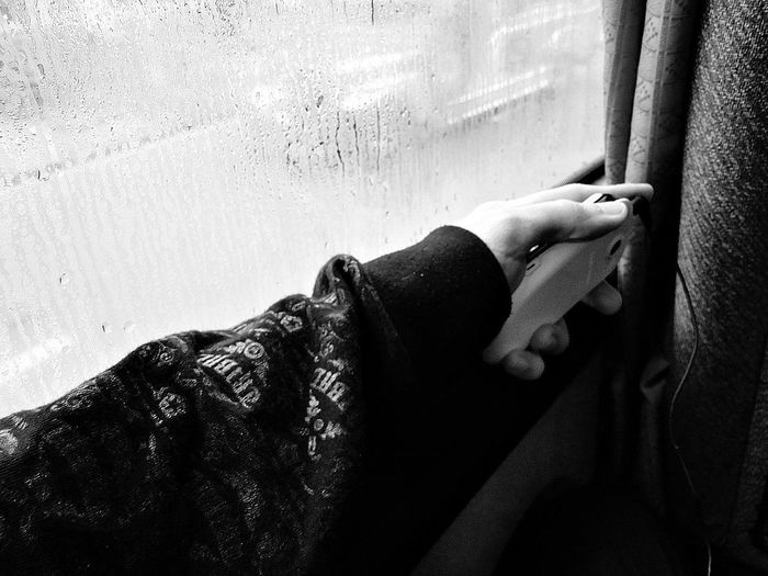 Alone Black And White Bus Ride Commute Human Hand In A Vehicle Mobile Phone Music Music Player Raining Sitting Window