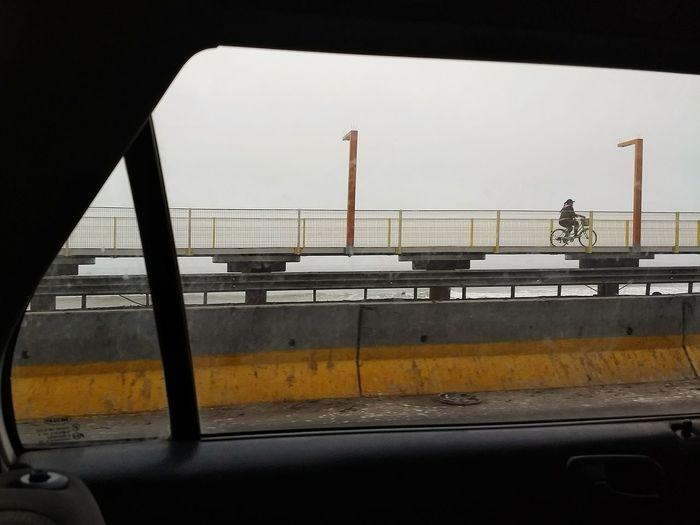 View of bridge through car window