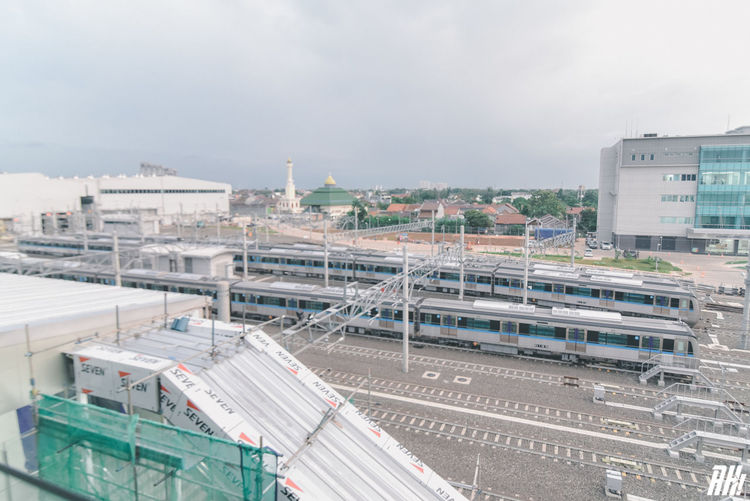 High angle view of train in city against sky