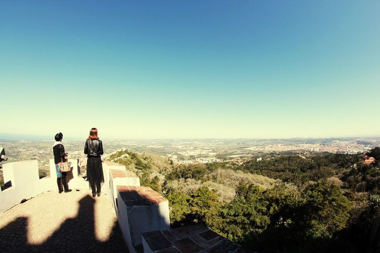 Women standing at observation point against sky