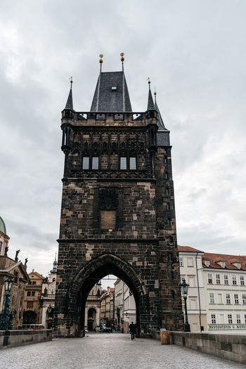 Tower in CHarles bridge of Prague against cloudy sky Charles Bridge Historical Building Old Town Bridge Tower Tower Bridge  Travel Arch Architecture Bridge - Man Made Structure Building Building Exterior Built Structure City Day Historic History Landmark Low Angle View Nature Outdoors Sky The Past Tourism Tower Travel Travel Destinations