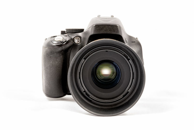 Front view of a black unbranded DSLR camera isolated on white background Black Color Camera Camera - Photographic Equipment Circle Close-up Cut Out Digital Camera Electrical Equipment Equipment Indoors  Lens - Eye Lens - Optical Instrument Man Made Object No People Photographic Equipment Photography Themes Silver Colored Single Object SLR Camera Still Life Studio Shot Technology White Background