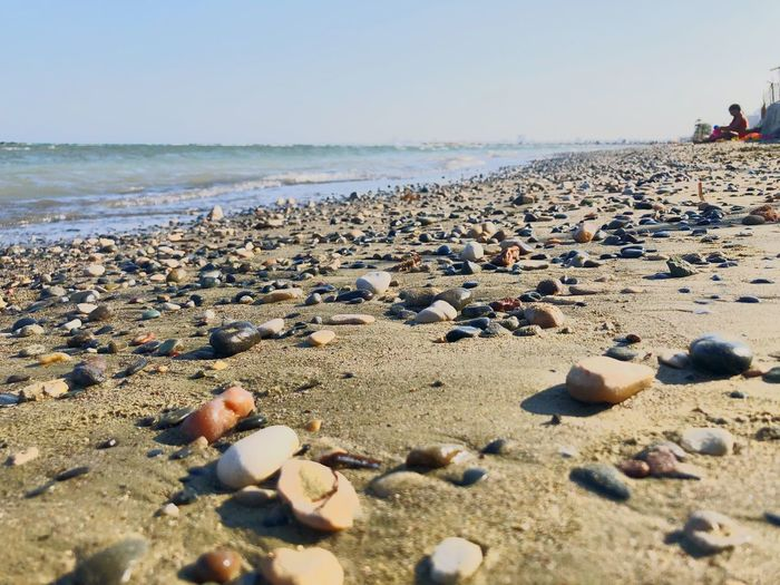 Shapes Formation Waves Sand Small Rocks Beach Water Relaxinh Summer Beach Land Sea Water Sand Sky Nature Sunlight Beauty In Nature Day Scenics - Nature Horizon Over Water Tranquility Stone - Object Horizon Rock Outdoors Solid Tranquil Scene Incidental People