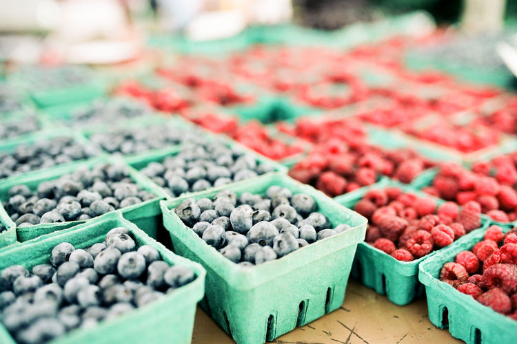 Berries Raspberries Abundance Blueberries Choice Close-up Consumerism Container Farmer's Market Focus On Foreground Food Food And Drink For Sale Freshness Fruit Healthy Eating Large Group Of Objects Market Market Stall No People Order Retail  Retail Display Selective Focus Still Life Variation Wellbeing
