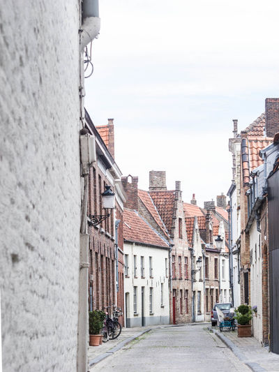 Brugge Town Life Wandering Film Photography Brick Building Church Architecture Eyeem Travel Quiet Places European Architecture Old Street Belgium Old Town Old Buildings Built Structure Building Building Exterior Architecture Narrow Street