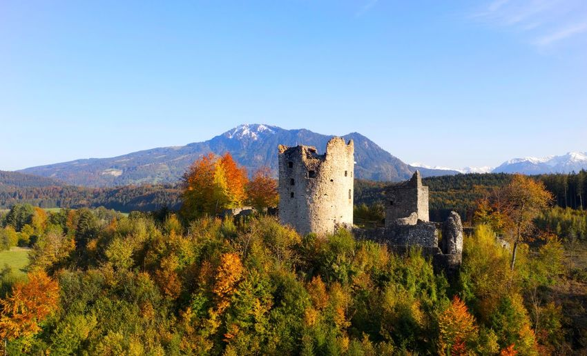 View of castle on mountain against blue sky