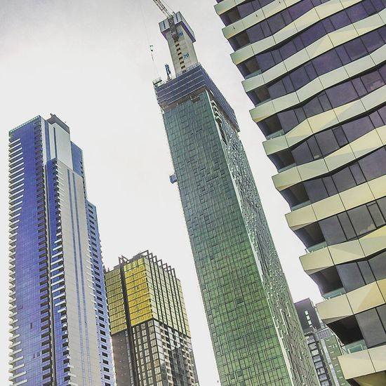Skyscraper Architecture Low Angle View Development Built Structure Building Exterior Growth City Modern Green Color Sky Day Outdoors No People Urban Skyline