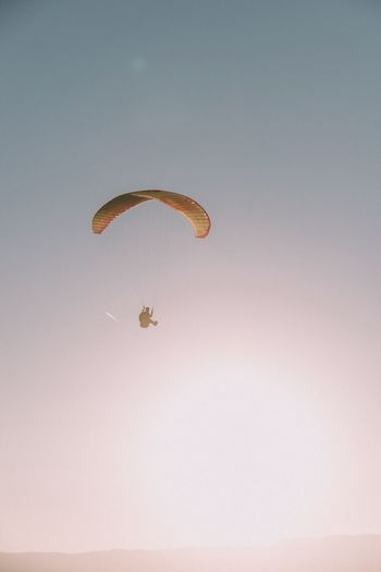 Low Angle View Of Paragliding Against Clear Sky