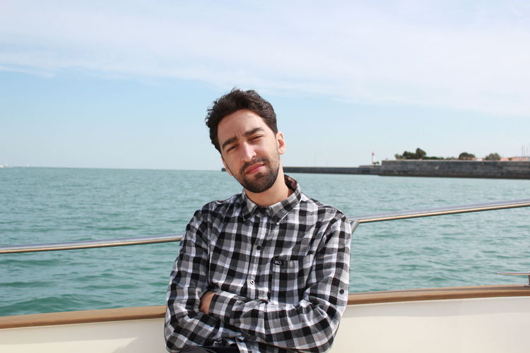Boat Leisure Activity Lifestyles Nature One Person One Young Man Only Portrait Sea Sky Travel Destinations Water