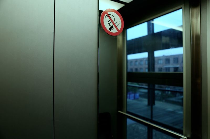 No smoking sign by glass window in building