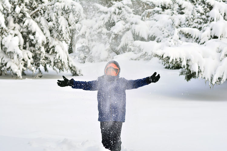 Magic of winter. Young boy playing with snow.. Action Beauty In Nature Boy Cold Cold Temperature Colorful Conceptual Fun Happiness Happy Motion Nature One Person Outdoors People Playing Recreation  Recreational Pursuit Snow Vacations Wallpaper White Winter Wintertime Young
