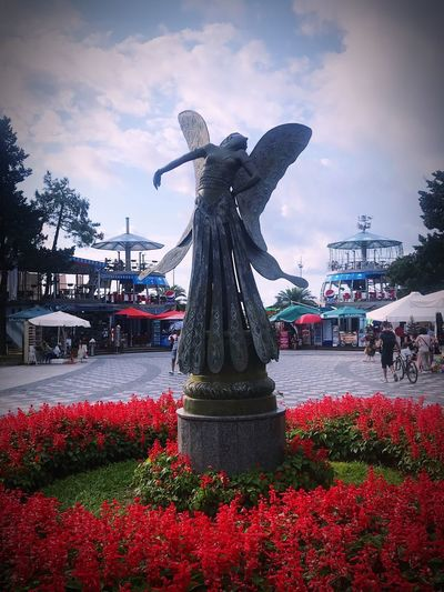 Batumi Representation Human Representation Art And Craft Sculpture Plant Statue Architecture Creativity Nature Flower Cloud - Sky Male Likeness Flowering Plant Incidental People Built Structure Red Day Sky Building Exterior Autumn Mood EyeEmNewHere 50 Ways Of Seeing: Gratitude