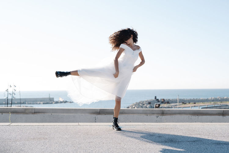 Full length of woman walking on beach