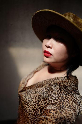 Mid adult woman wearing hat and red lipstick