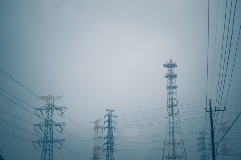 Cable Communication Connection Day Electricity  Electricity Pylon Electricity Tower Fog Fuel And Power Generation Low Angle View No People Outdoors Power Line  Power Supply Sky Tall Technology