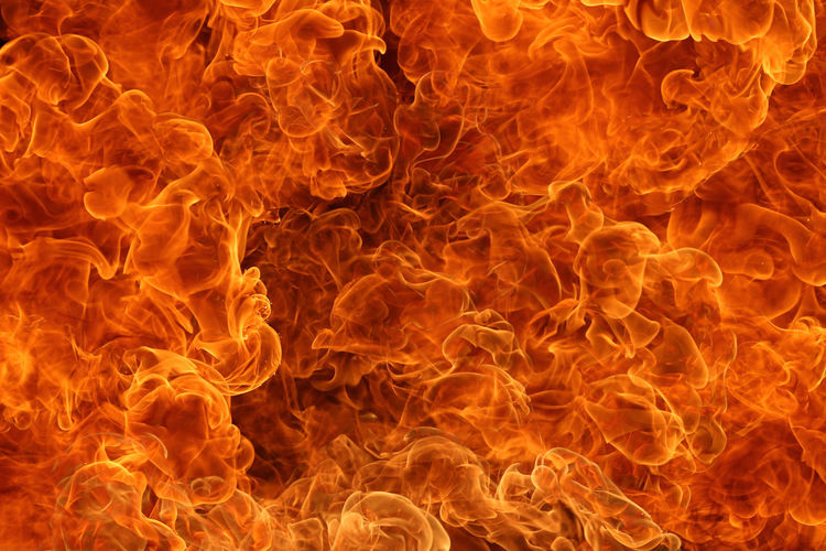 Close-up of yellow fire against black background