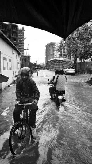 City Street Outdoors Bicycle Road Street People Day Black And White Real People Monsoon Mumbai Monsoon MumbaiDiaries Mumbai Potholes Road Black And White Friday Visual Creativity Adventures In The City