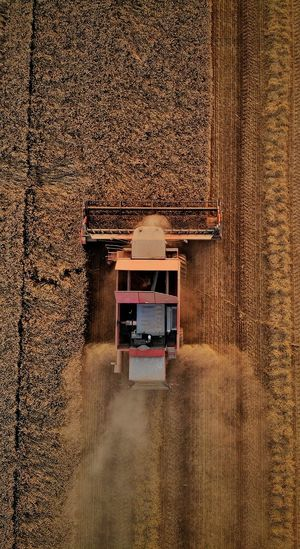 Directly above shot of agricultural machinery on land