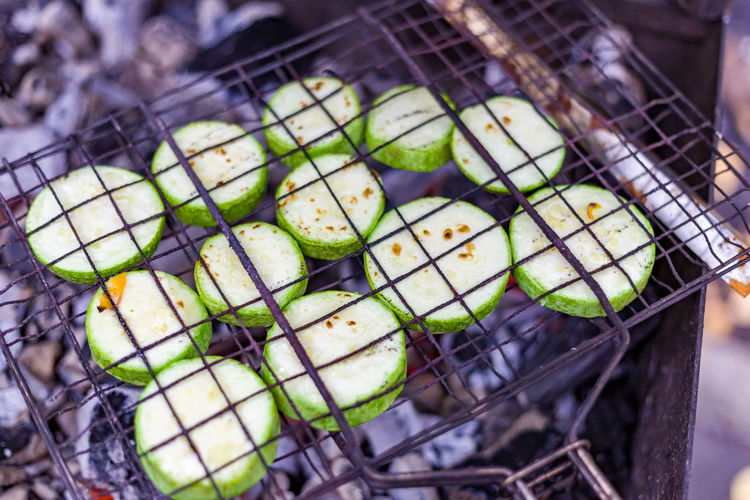 High angle view of chopped vegetables on barbecue grill