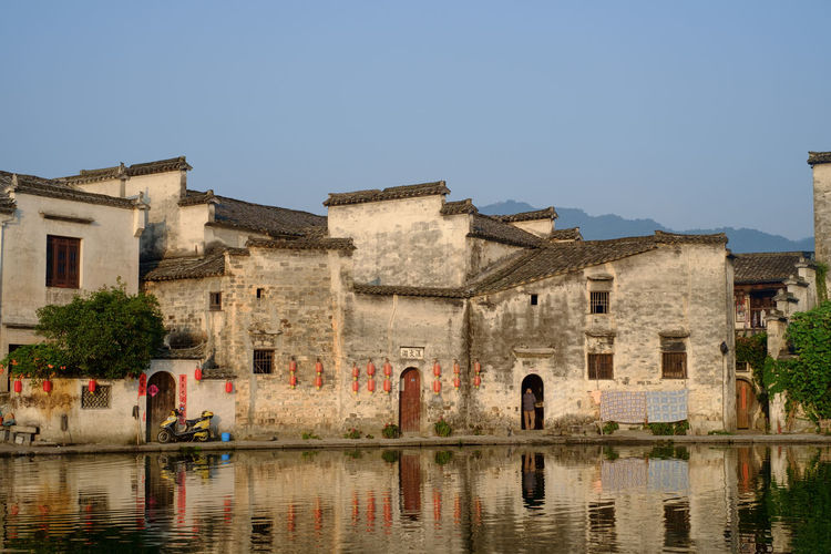 Hong cun China Photos Travel Architecture Building Building Exterior Built Structure China Clear Sky Copy Space Day History Incidental People Lake Nature Outdoors Reflection Residential District Sky The Past Travel Destinations Water Waterfront EyeEmNewHere