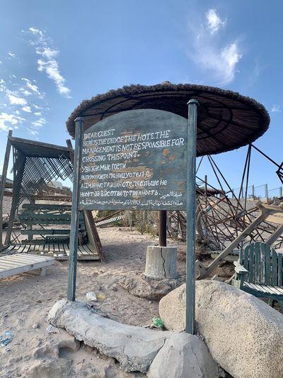 Information sign on rock against sky