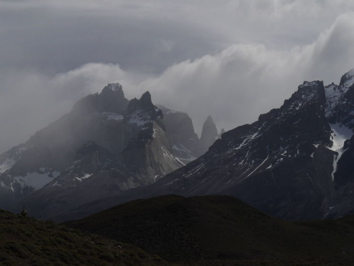 Scenic view of mountains against cloudy sky, torres del paine mountain
