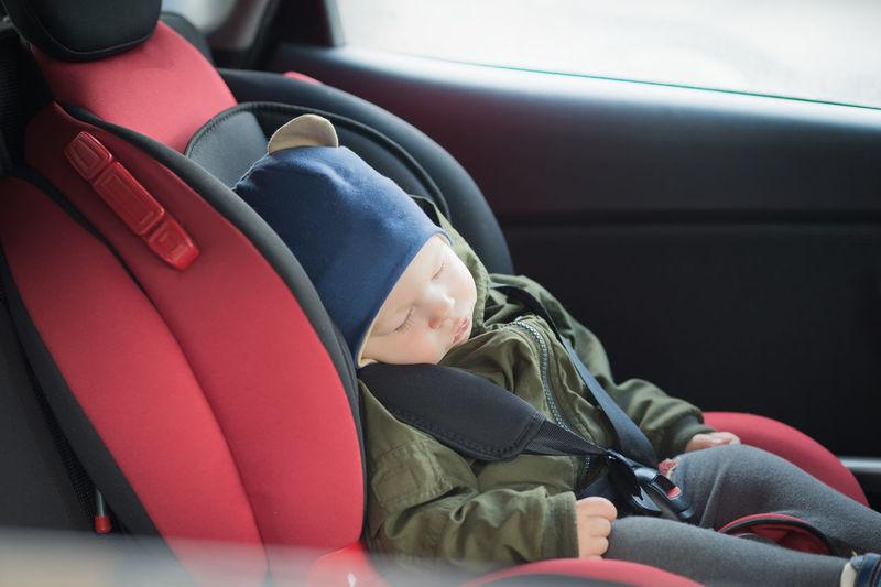 Cute baby boy sleeping in car