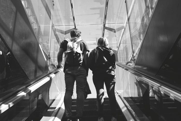 """I wish I could walk with you forever, but I can't. I must go sometime."" Bwphotography Street Photography People Watching Stories Couple Men Full Length Architecture Escalator Hand Rail"