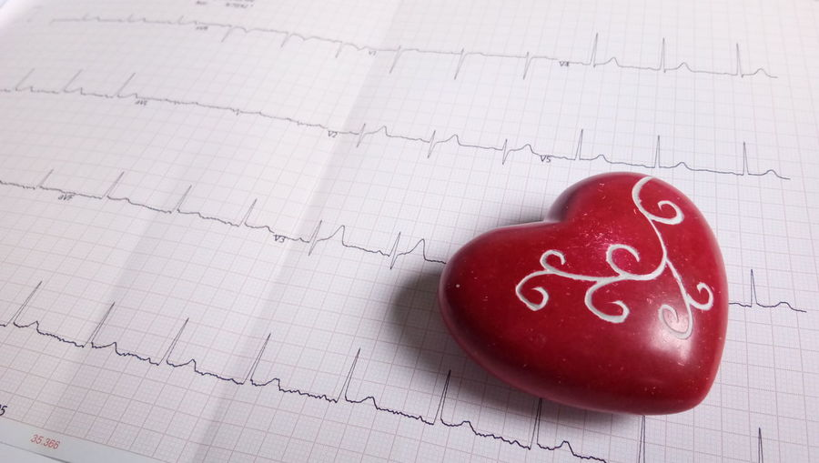 Close-Up Of Heart Shape On Pulse Trace Paper