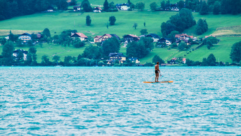Adventure Attersee Austria Beauty In Nature Day Extreme Sports Healthy Lifestyle Holidays Lake Leisure Activity Lifestyles Nature One Person Outdoors Paddleboarding People Real People Sky Sport Standing Vacations Water