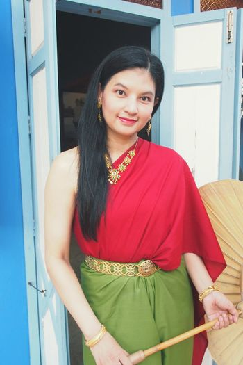 Portrait Of Woman Wearing Traditional Clothing While Standing Against Door
