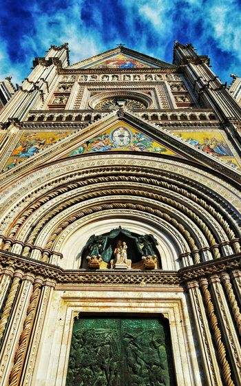 """Reaching for Heaven"" - Orvieto Orvieto Photobydperry Italy Italia Church Architectural Detail Architecture Built Structure Building Exterior Place Of Worship Cloud - Sky Outdoors No People Religion Spirituality Historical Place Bascilica Duomo Orvieto"