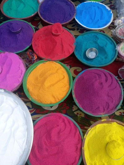 Art And Craft, Choice Circle Cultures Day Diwali Holi Indian Culture, Market Market Stall Merchandise Multi Colored No People Outdoors Powder Paint Religion Retail  Variation Vehicle Breakdown Vertical