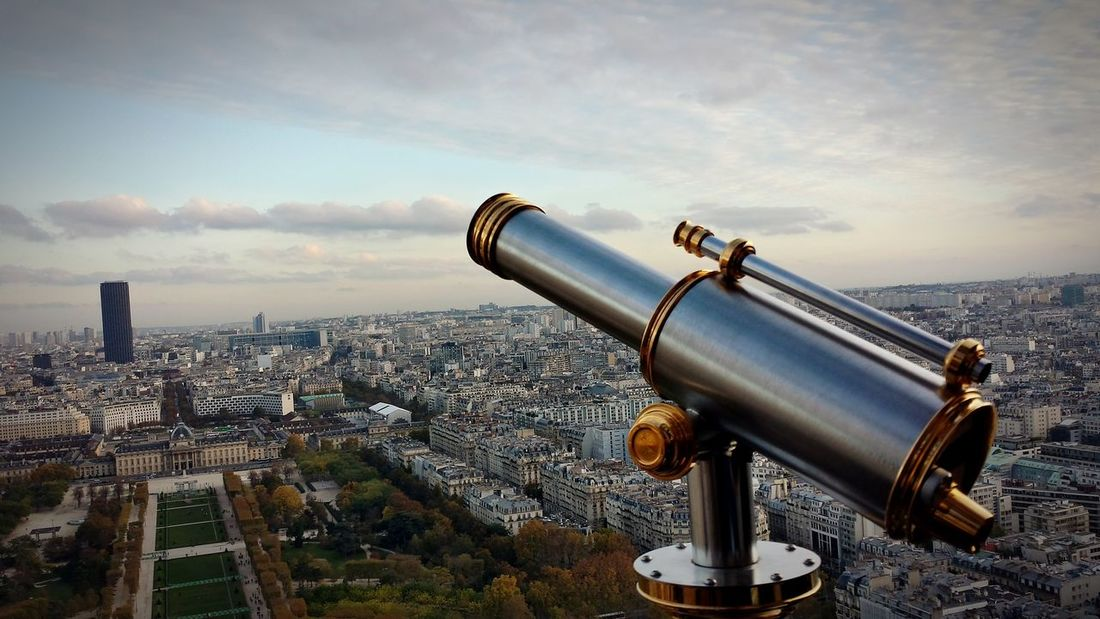 EyeEm Selects Coin-operated Binoculars Cityscape Hand-held Telescope City Telescope Surveillance Watching Cloud - Sky Travel Destinations Urban Skyline Technology Architecture Sky No People Scenics Modern Skyscraper Outdoors Day Close-up France Paris Tour Eiffel Visual Creativity Adventures In The City Focus On The Story The Creative - 2018 EyeEm Awards